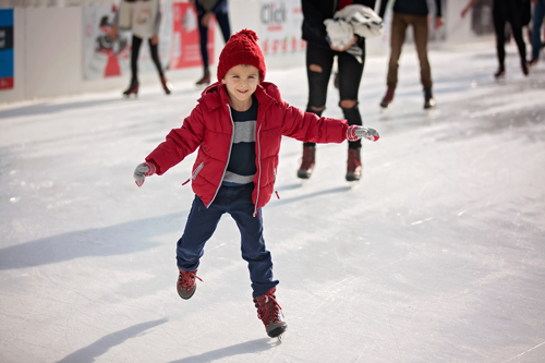 child ice skating in pompey