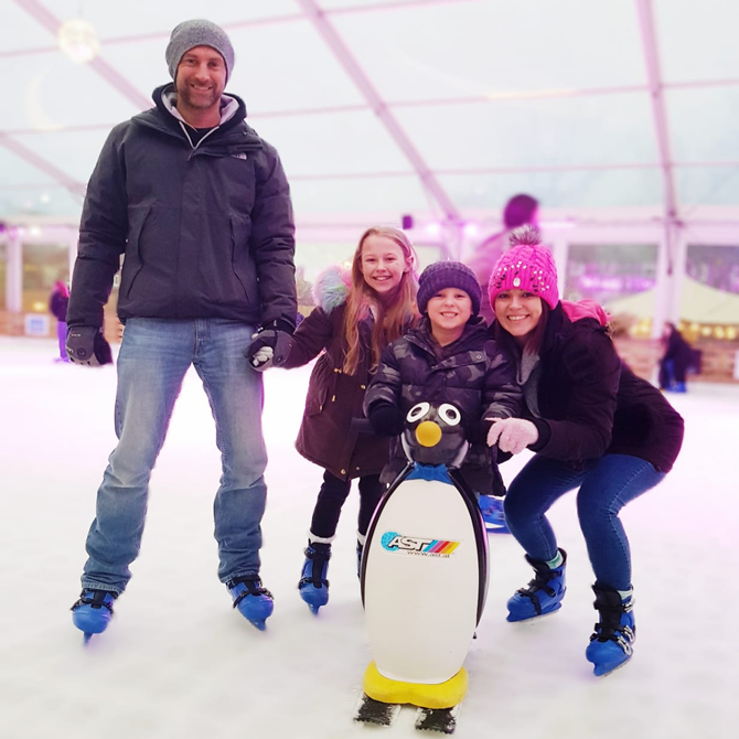 Family on Ice Skates on Ice Rink